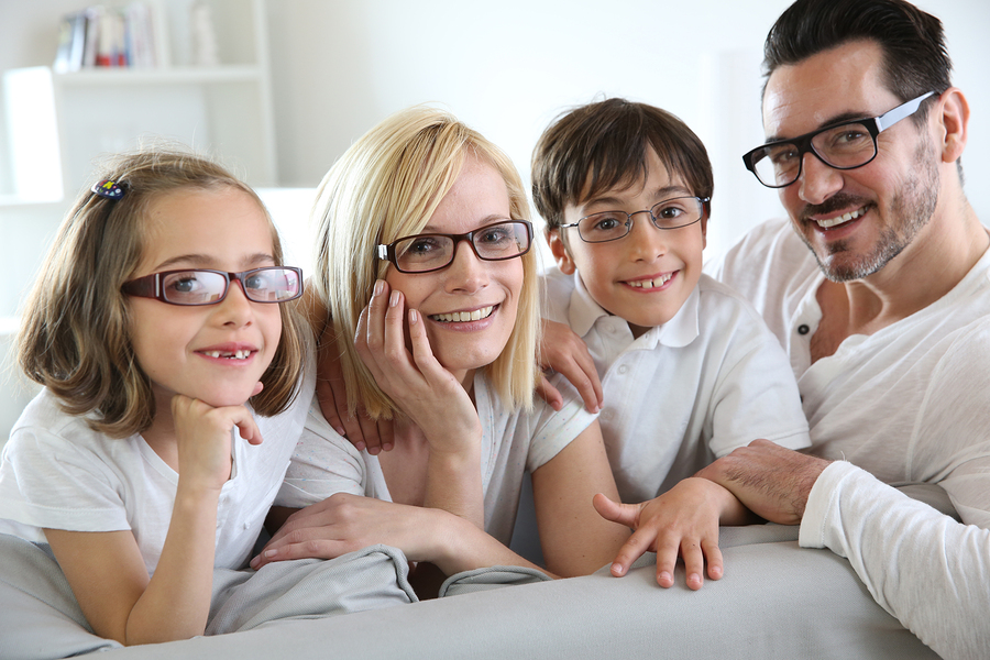 family all wearing glasses looking at the camera
